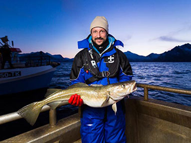 Crown Prince Haakon shows off his catch during HRH's visit to the northern island of Senja for the opening of the fishing season.