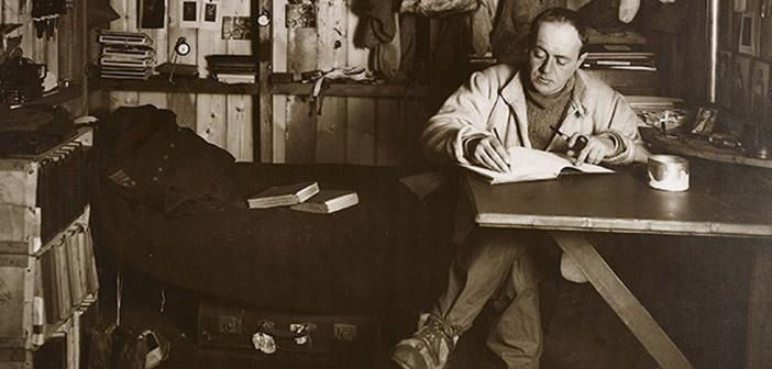 Herbert Ponting's study of Captain Scott writing in his diary taken on October 7, 1911.