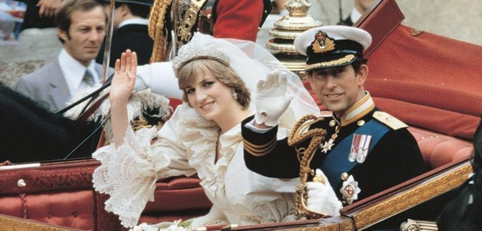 29 July 1981. The wedding of The Prince of Wales and Lady Diana Spencer. The newlyweds are pictured as the royal carriage takes them back to Buckingham Palace following the wedding at St. Paul's Cathedral.