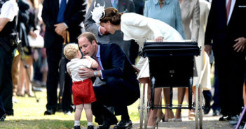 The Duke and Duchess of Cambridge. William picks up Prince George and Kate takes baby Princess Charlotte to her christening.