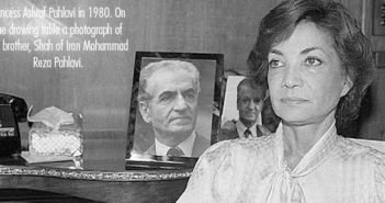 Princess Ashraf Pahlavi in 1980. On the drawing table a photograph of her brother, Shah of Iran Mohammad Reza Pahlavi.